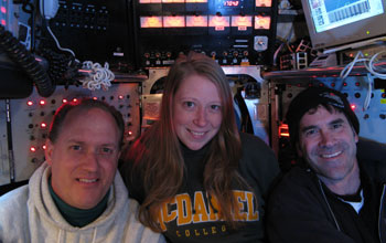 Photo of scientists James Holden, left, and Helene Ver Eecke with Alvin pilot Bruce Strickrott.