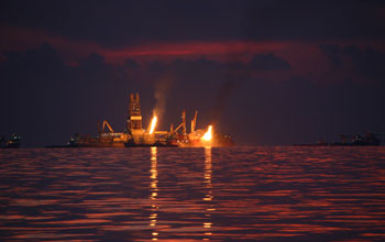 Photo showing flares of captured gas and oil at the Deepwater Horizon spill site in June 2010.