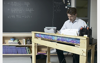 Math teacher at desk