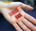 Photo of ingestible origami robot shown in the palm of a hand