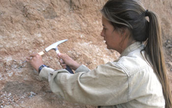 Photo of paleontologist Nancy Stevens at work in the Rukwa Rift Basin.