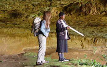 Nancy Stevens with Tanzanian geologist Evelyn Mbede survey the field