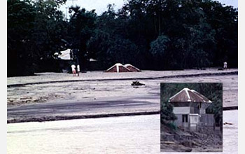 Photo of a house buried by a mudflow of volcanic ash and debris after Pinatubo's eruption.