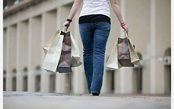 Photo of woman holding shopping bags.