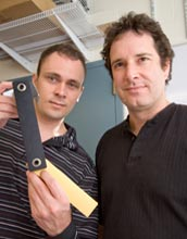 Photo of Cornell University researchers holding up a double pendulum.