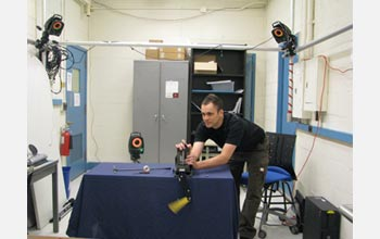 Photo of Cornell University doctoral student Michael Schmidt setting up testing equipment.