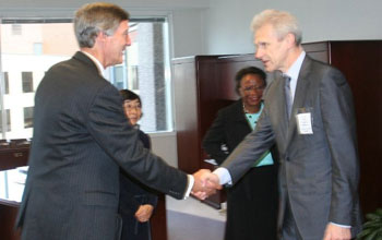 NSF's David Stonner, Machi Dilworth and Cora Marrett greet Russian Science Minister Andrei Fursenko.