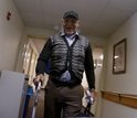 Robot's view of a resident as they walk together down the hallway of an eldercare facility.