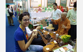 Photo of cultural anthropologist Margie Serrato learning how to properly drink tea in South Korea.