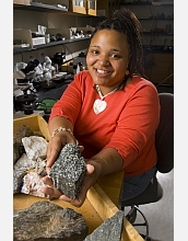 Female scientist in lab with geologic samples