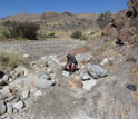 Photo of scientist Paul Bierman sieving a river bed to extract the medium sand fraction.