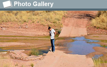 Kyle Nichols viewing a wet river crossing with words Photo Gallery and photo icon.
