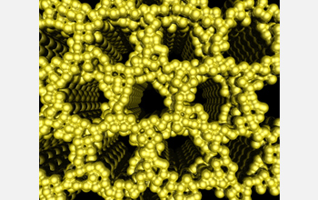 Illustration showing shimmering platinum atoms forming a gaping honeycomb structure.