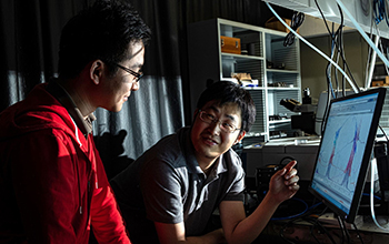 graduate student Xinwei Li, left, and postdoctoral researcher Weilu Gao