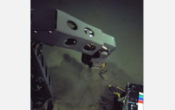 Photo of the hybrid remotely operated vehicle Nereus collecting sediment from the Mariana Trench.