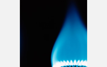 Photo of bllue flame from burning of methane.