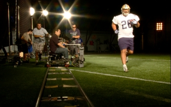 Runningback Duce McAllister is filmed by a state-of-the-art, high-speed Phantom camera.