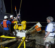 Night deployment of an ocean bottom seismograph.