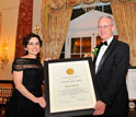 Photo of NSB's France C�rdova presenting the 2011 Vannevar Bush Award to Charles Vest.