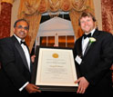 Photo of NSF Director Subra Suresh presenting the Alan T. Waterman Award to Casey Dunn.