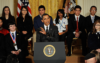 President Obama with a group of young people seated behind him