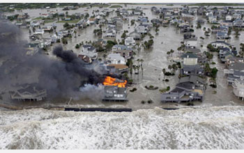 Photo of a house burning on Galveston Island, Texas, as Hurricane Ike hits the Gulf Coast in 2008.