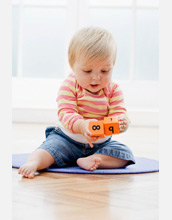 Photo of a baby playing with numbered blocks.
