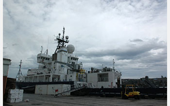 R/V Roger Revelle in port in Dunedin, New Zealand, showing antenna atop that provides internet.