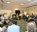 Poeple sitting in a circle at the NSF's BRAIN workshop