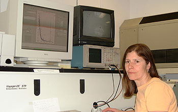 Researcher in front of lab equipment