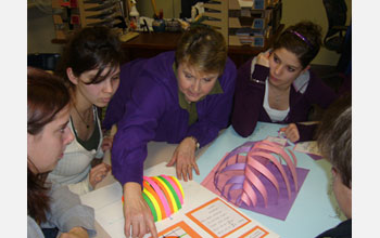 Photo of teacher Diane Schnellhammer working with students on a math project.