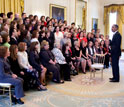 Photo of President Obama greeting teachers in the East Room of the White House.