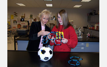 Photo of science teacher Jeanine Gelhaus discussing nanostructures with a student.