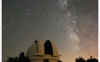 Photo of the summer Milky Way behind the Hale Telescope at the Palomar Observatory.