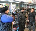 researchers talking to chinese locals in a store in Wolong