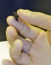 Photo of hand holding new nanocomposite paper