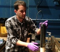Scientist Blair Paul prepares a sediment core for further sampling