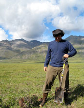 Photo of Andrew Jacobson doing fieldwork in Alaska.