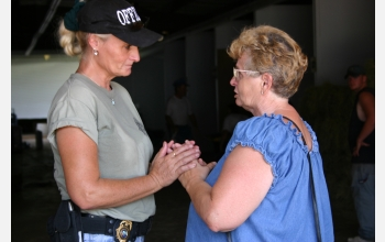 Okaloosa (Fla.) animal services director comforts a woman seeking a temporary home for her dog.