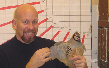 Ken Dial with an adult chukar partridge