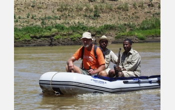 Frank Brown crossing the Omo River accompanied by Tamrat Haile Mariam and Zmaneh Shugut.