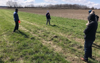 Members of the SAVANT team checking topography for the project.