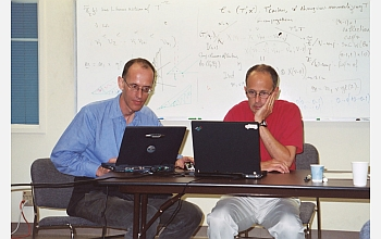 Atlas of Lie Groups Project members Fokko du Cloux (left) and Jeffrey Adams discuss E8.