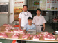 Photo of David Ortega and Laping Wu with a pork seller in Shijiazhuang, Hebei Province, China.