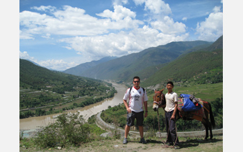 Photo of David Ortega and a man with a donkey at Tiger Leaping Gorge, Yunnan Province, China.
