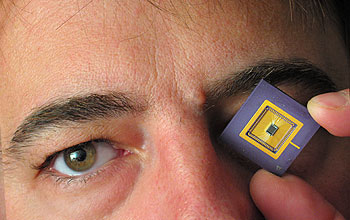 Vladimir Brajovic holding an image sensor similar to proposed chip