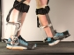 legs walking with prosthetic limbs on treadmill
