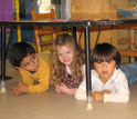 Photo of pre-school students practicing Drop, Cover and Hold On in Santa Barbara, Calif.