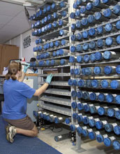 Photo of geologist Kristin Hillis labeling newly retrieved sediment cores in a shipboard lab.