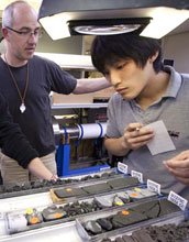 Photo of scientists Michael Stipp and Masaoki Uno choosing samples for analysis.